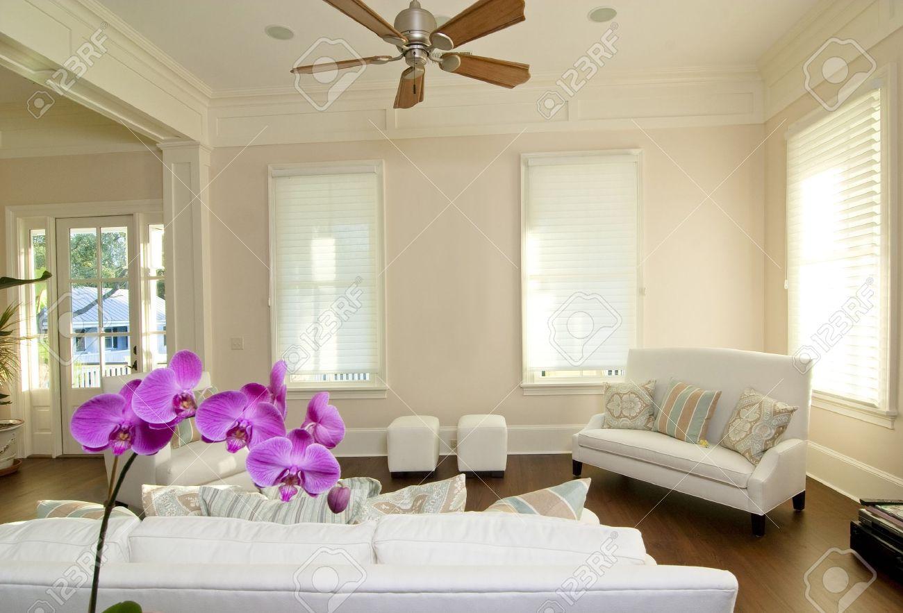 Modern White Furniture For Living Room Beautiful Modern Livingroom With White Furniture And Orchid Stock