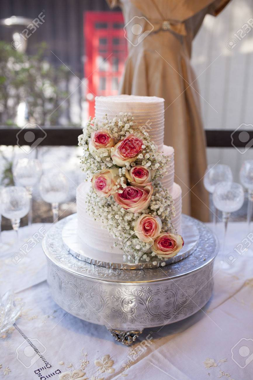 Beautiful Three Tiered Wedding Cake With Roses, Shallow Focus ...