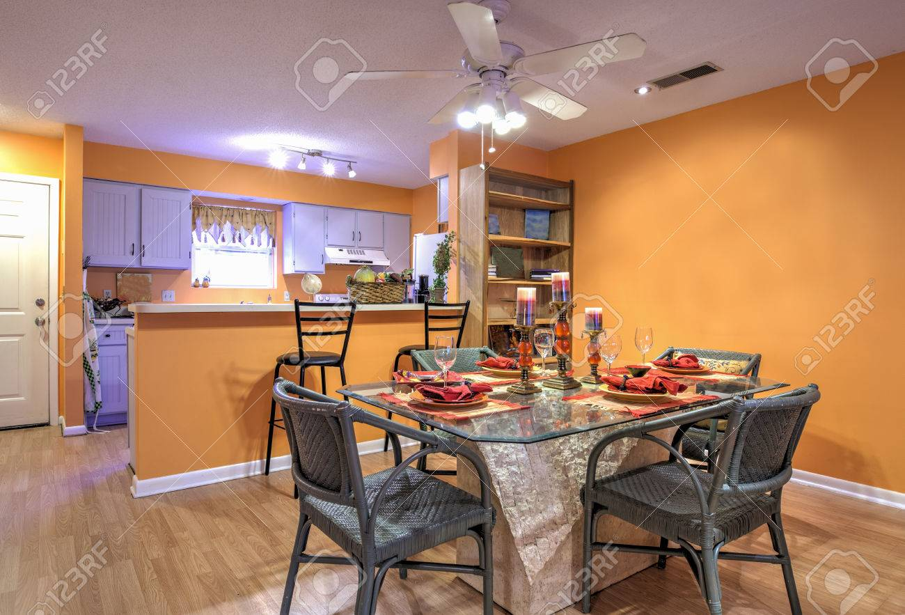 Open Concept Apartment With Diningroom And Kitchen And Orange