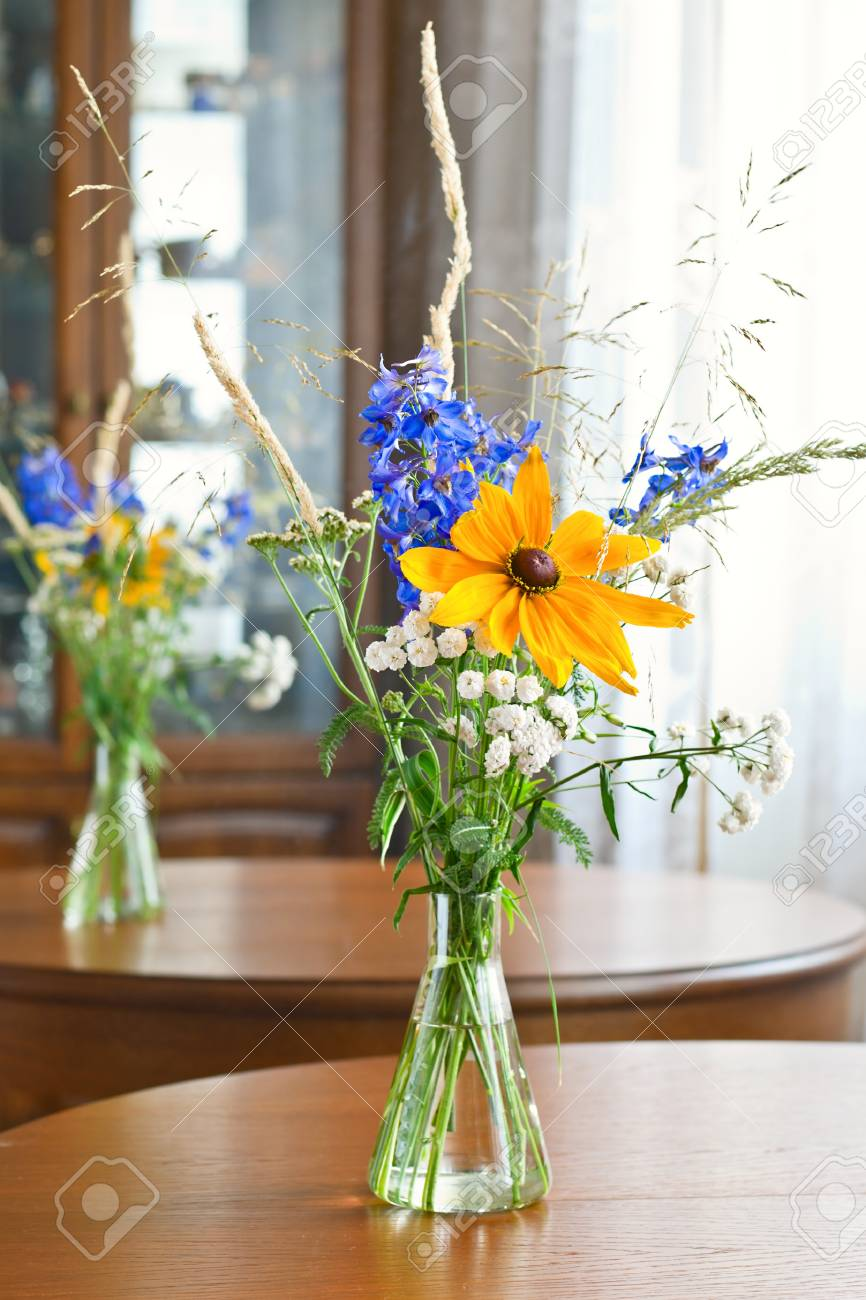 Bouquet of wild flowers on wooden table Stock Photo - 11796191