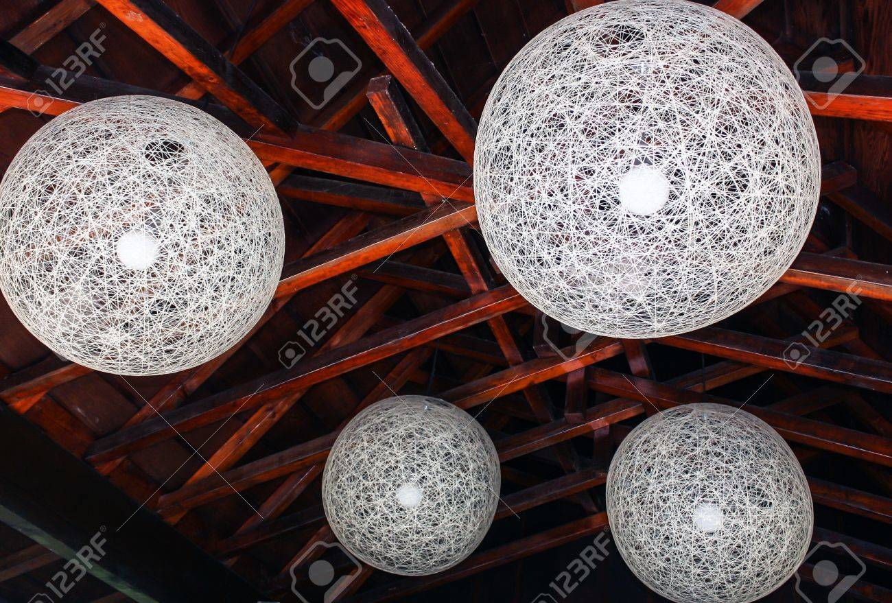 Orbital Decorative Ceiling Lights with Rafters Stock Photo - 16106056