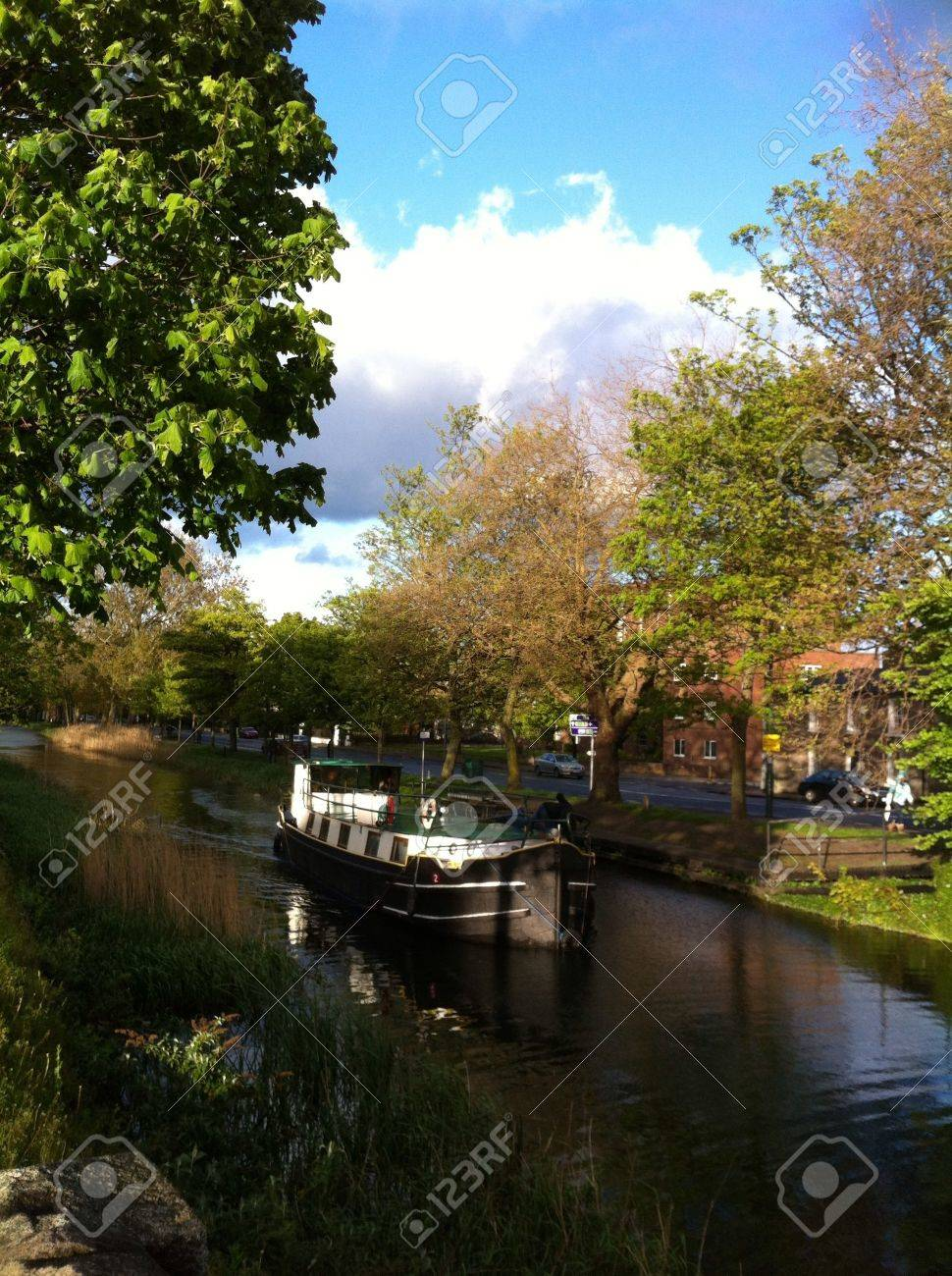 Canal boat navigating along the Grand Canal Dublin between Ballsbridge and Ranelagh. Taken on a sunny day Stock Photo - 20401638