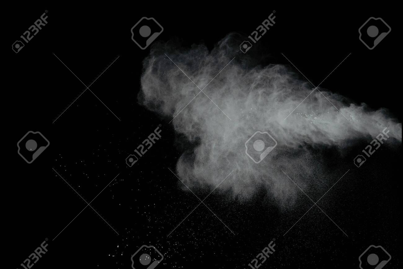 White powder explosion isolated on black background - 146795380