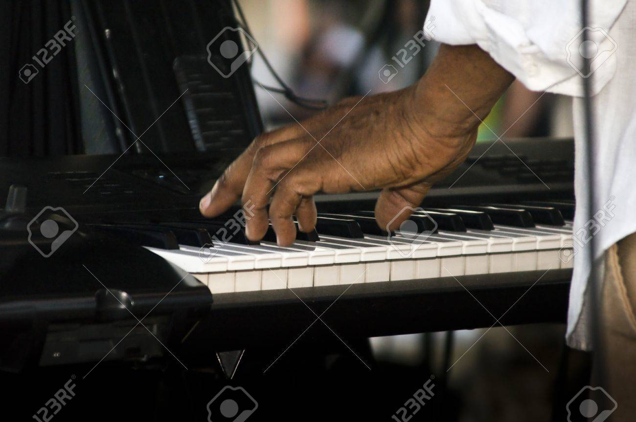 A musician tickles the ivories on an electronic keyboard Stock Photo - 15197468