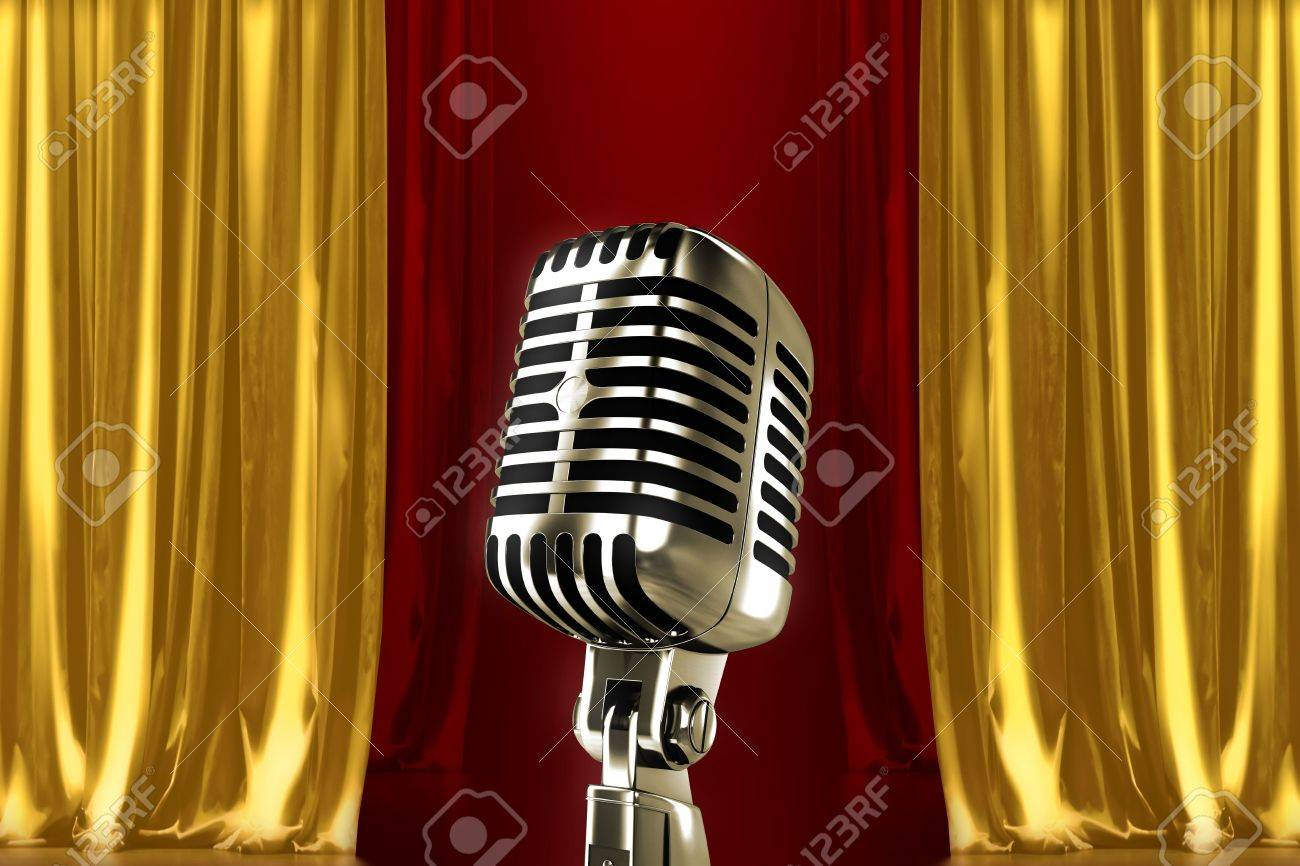 Glowing Microphone On Stage With Red Gold Curtains Stock Photo