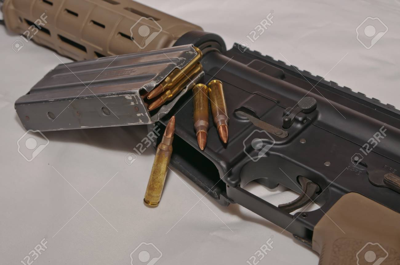 The upper of a black and brown 223 caliber AR-15 rifle with a