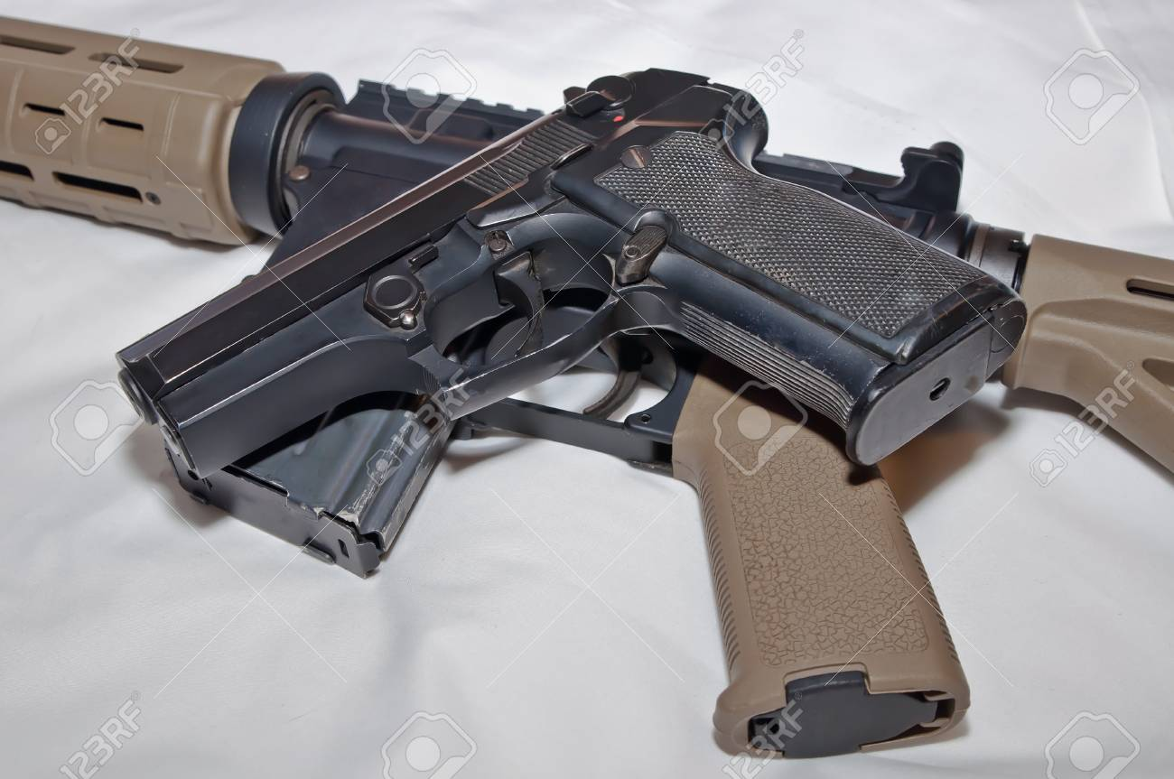 A black semiautomatic 40 caliber handgun on top of a black and