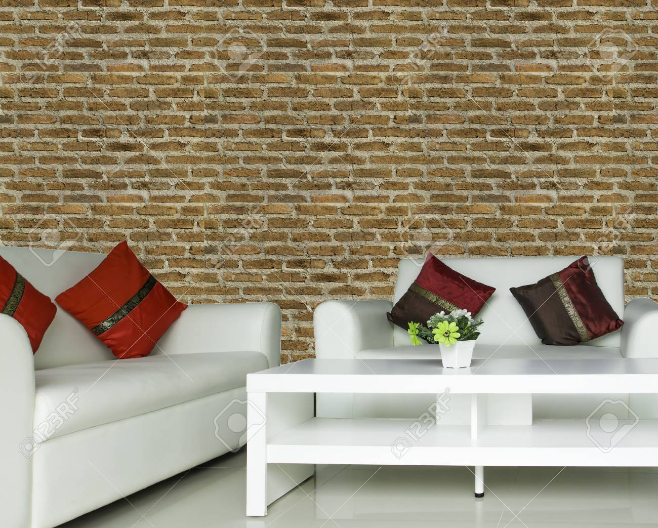 Many Color Cushions On White Sofa Set In Living Room With Brown