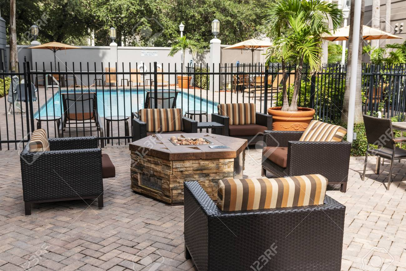 The Patio Of A Hotel It Set Up With A Ire Pitt A Pool And Furniture Stock Photo Picture And Royalty Free Image Image 114866372