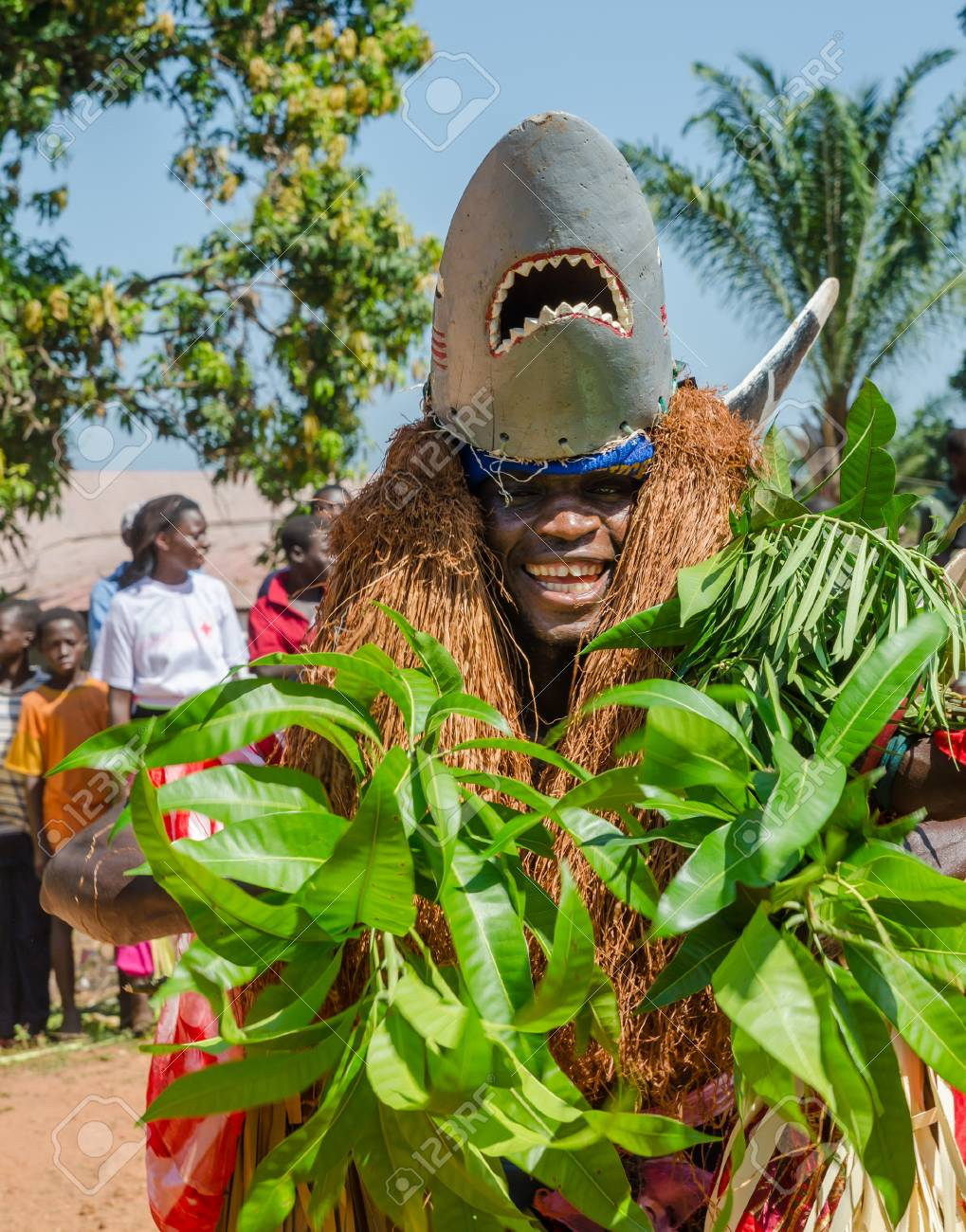 Bubaque, Guinea Bissau - December 07, 2013: Unidentified African man in traditional shark costume doing ritual dance - 117052554