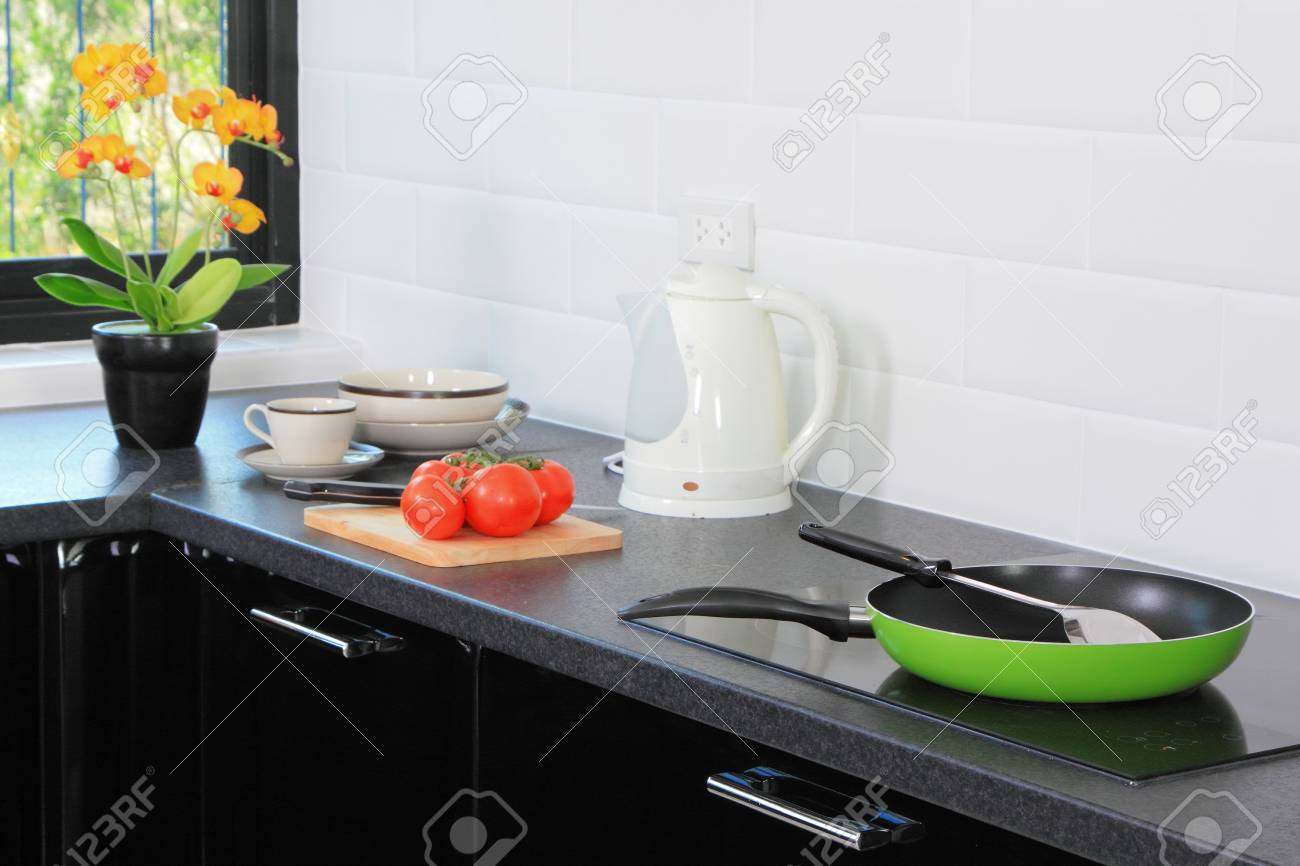 Modern kitchen accessory Unique Modern Kitchen Of Home With Accessory On Table And Foods Stock Photo 14754360 123rfcom Modern Kitchen Of Home With Accessory On Table And Foods Stock