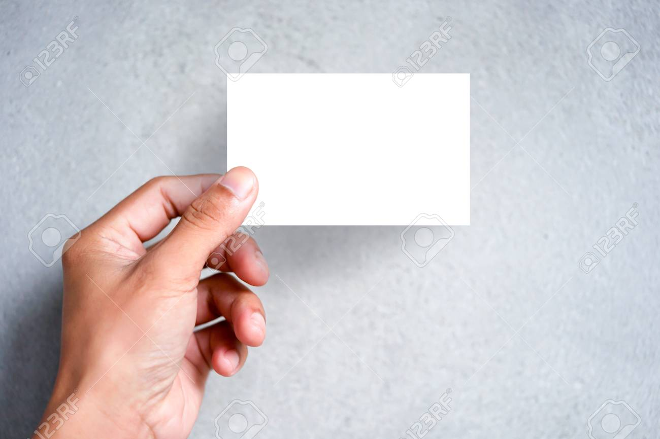hand holding blank plain white business card design mock up clear call id card mock