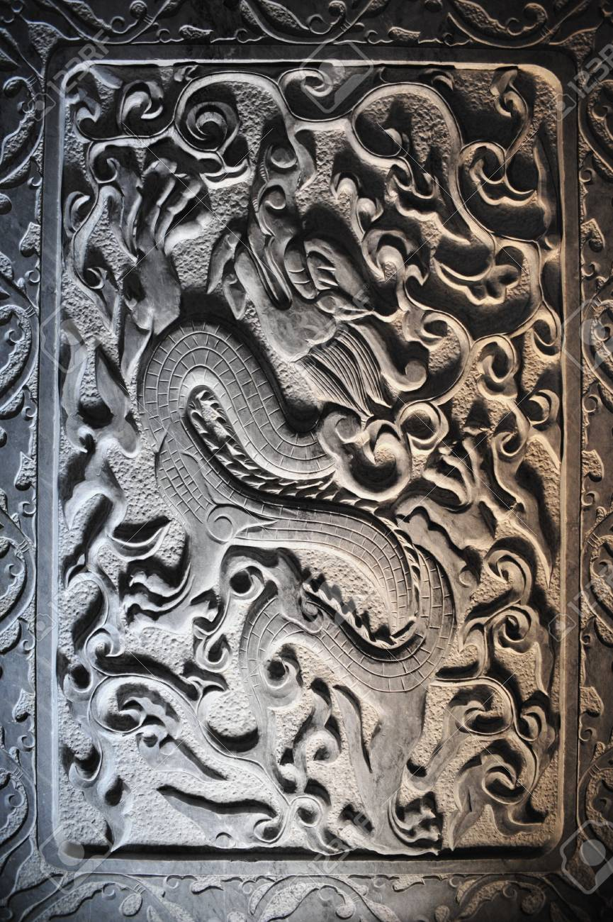 Dragon stone sculpture in wall chi stock photo picture and