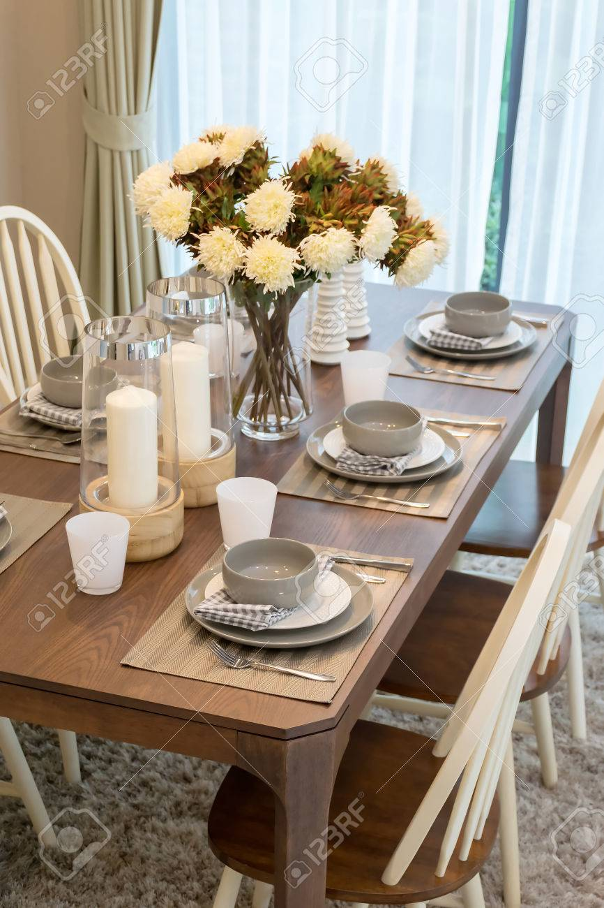 dining table and comfortable chairs in modern home with elegant..