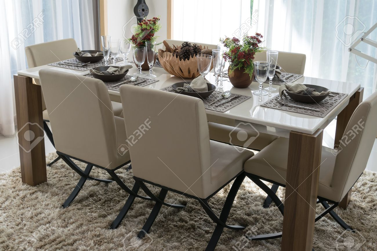 Dining Table And Comfortable Chairs In Modern Home With Elegant ...