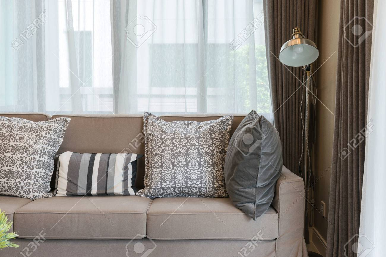 Superbe Stock Photo   Sturdy Brown Tweed Sofa With Grey Patterned Pillows