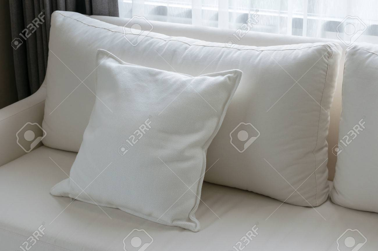 Stock Photo   White Decorative Pillows On A Casual Sofa In The Living Room