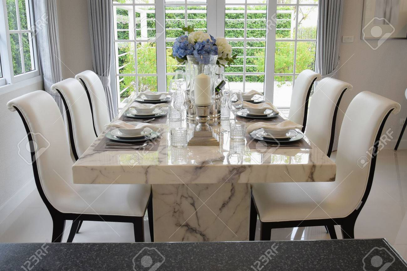 Kitchen Table Settings Dining table and comfortable chairs in vintage style with elegant dining table and comfortable chairs in vintage style with elegant table setting stock photo 41751865 workwithnaturefo
