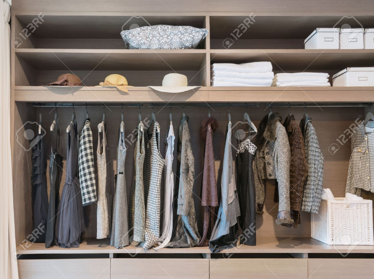 Modern Closet With Row Of Dress Hanging On Coat Hanger In Wardrobe. Stock  Photo