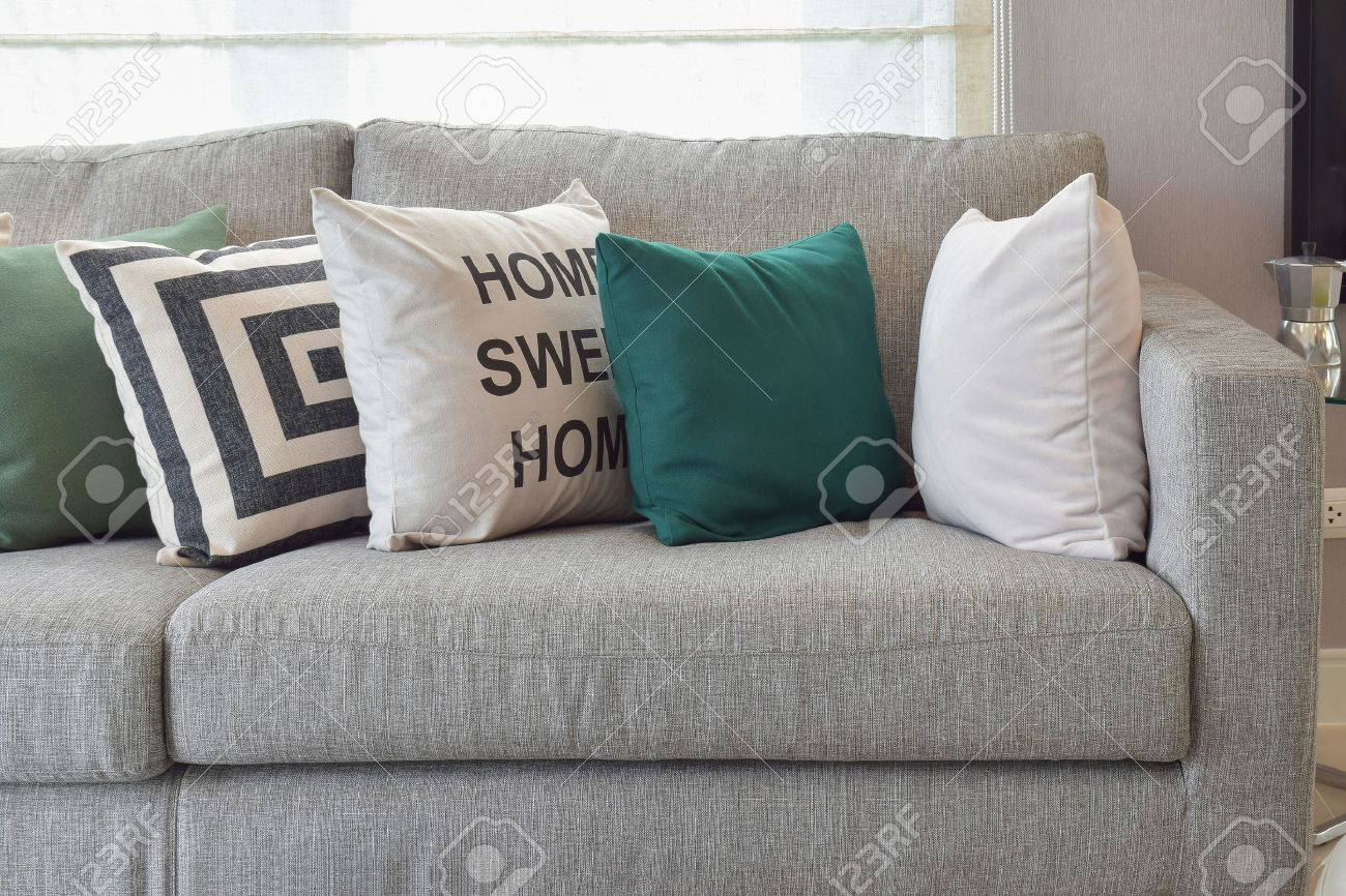 living room pillow. Retro pillows on the cozy grey sofa in living room Stock Photo  42537488 Pillows On The Cozy Grey Sofa In Living Room