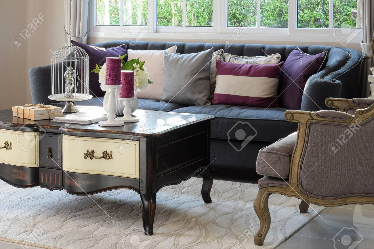 Luxury Living Room Design With Classic Sofa, Armchair And Decorative Set On  Wooden Table Stock