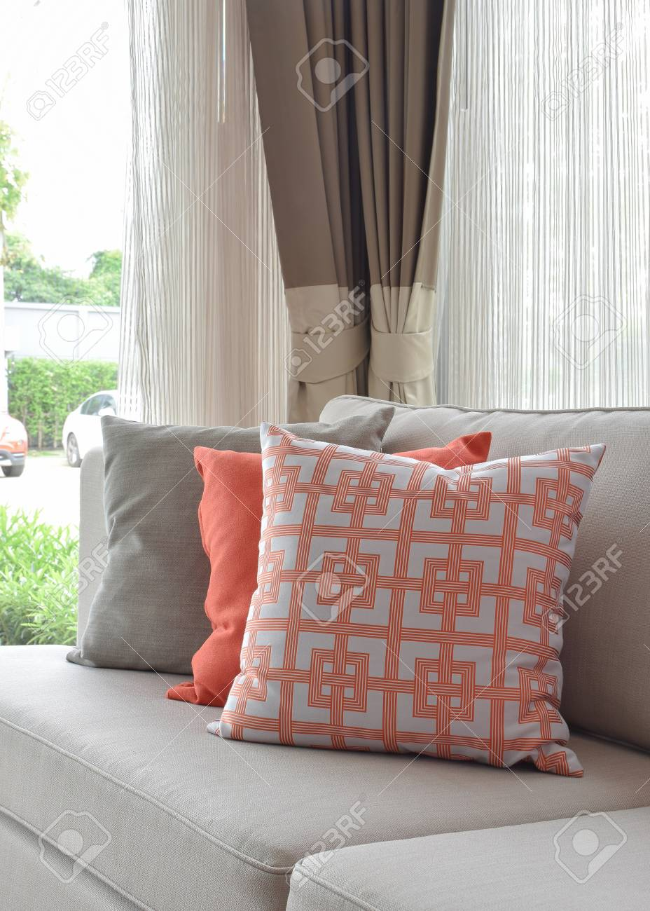 Sensational Graphic Pattern Orange And Gray Pillow On Beige Sofa Machost Co Dining Chair Design Ideas Machostcouk
