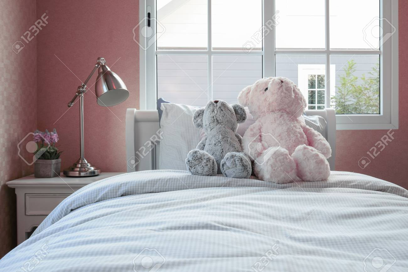 Kids Room With Dolls And Pillows On Bed And Bedside Table Lamp Stock Photo    47275760