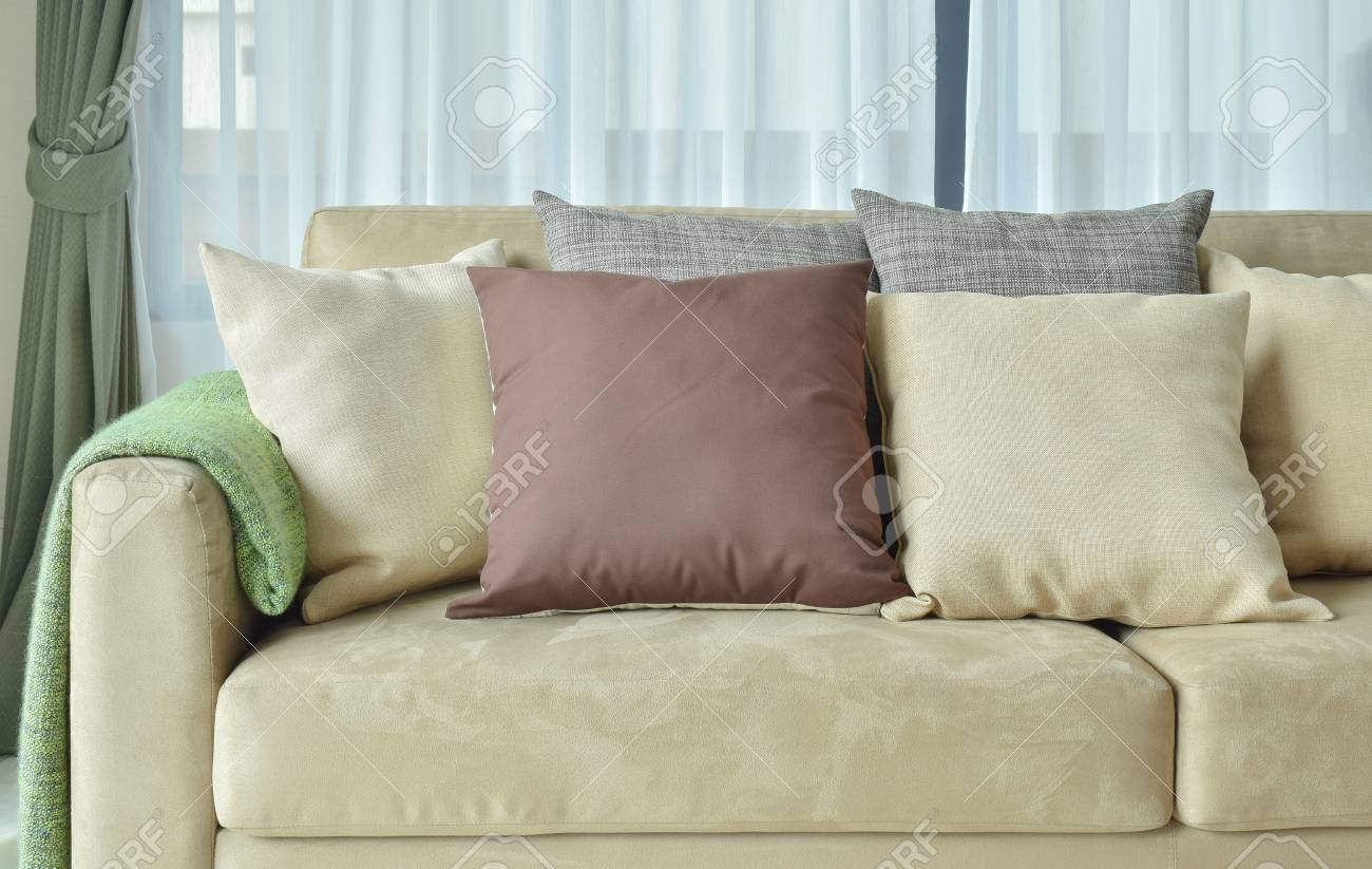 Brown Pillows On Light Brown Leather Sofa Stock Photo Picture And