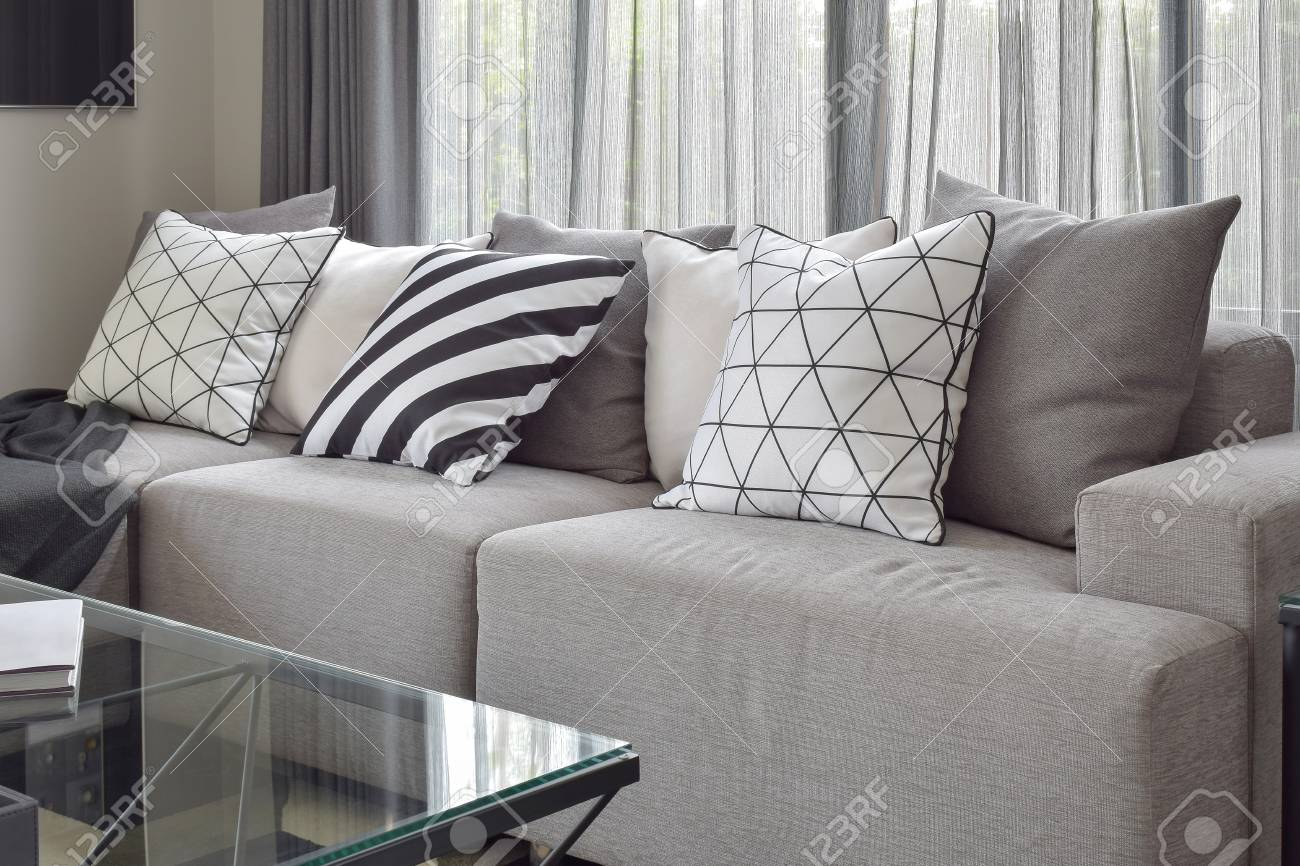 Light Gray Sofa With Varies Pattern Pillows In Modern Living Stock
