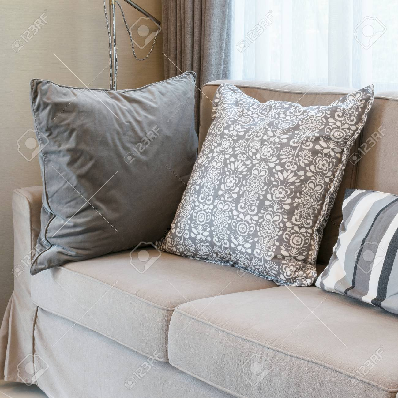 Living Room With Brown Sofa And Grey Patterned Pillows Stock Photo Picture And Royalty Free Image Image 58012329