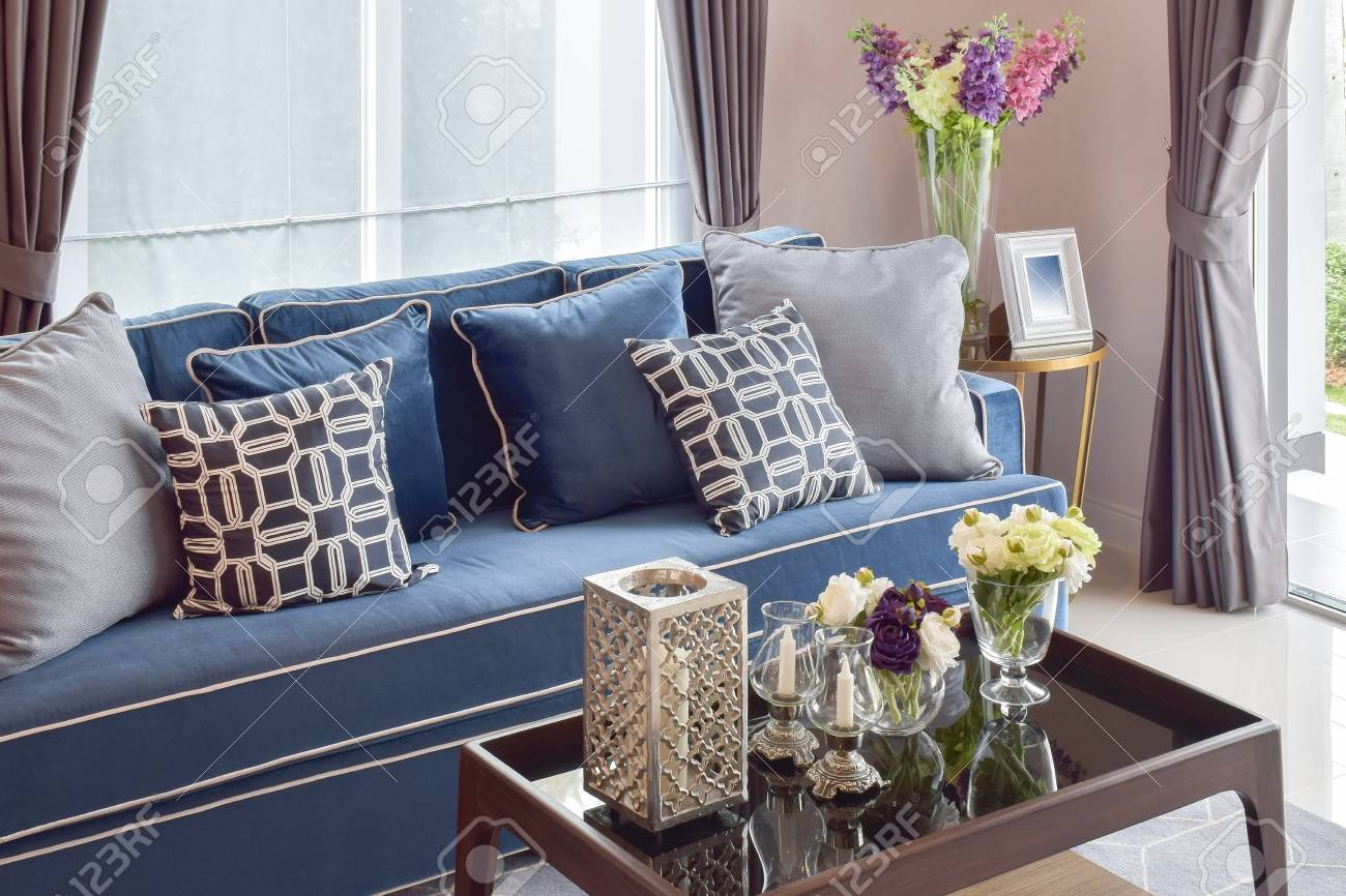 Romantic candle set with beige and blue modern classic sofa in..