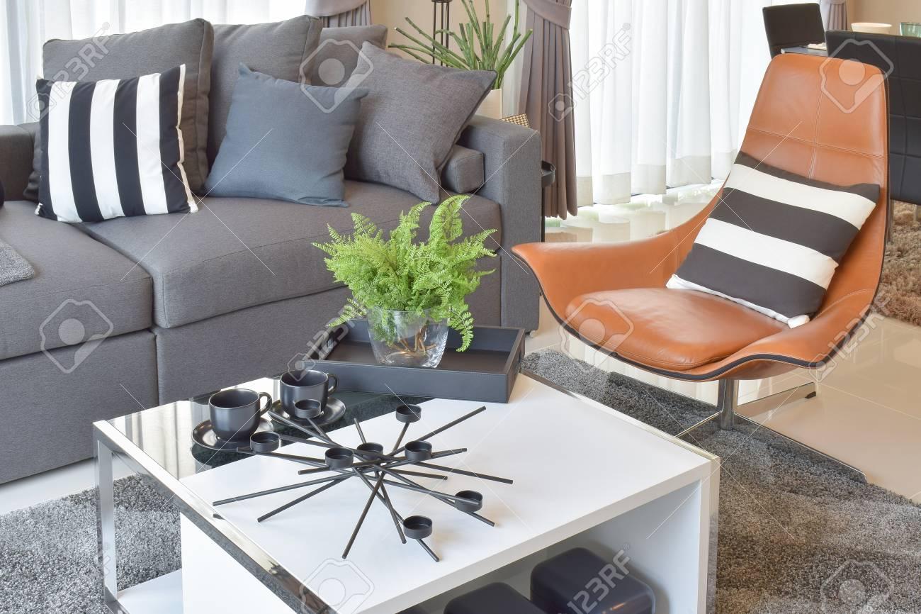 Stylish Living Room Design With Grey Pillows On Comfortable Sofa