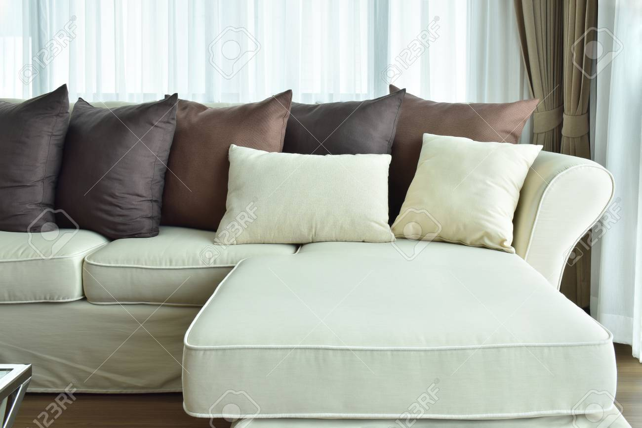 L Shape Beige Sofa With Varies Brown Color Of Pillows Stock Photo   61717400