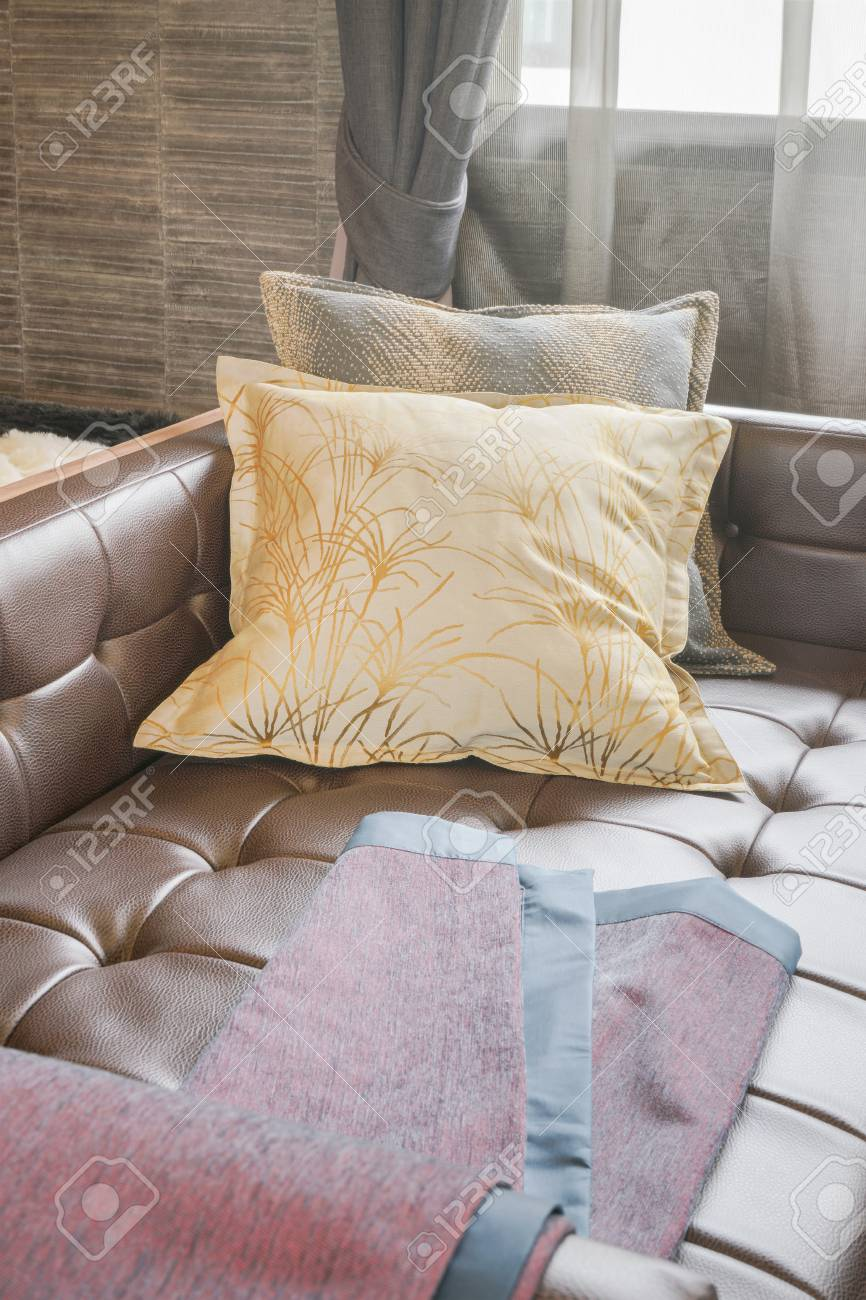 Scarlet Fabric On Leather Sofa Bed With Yellow Pillow In Living