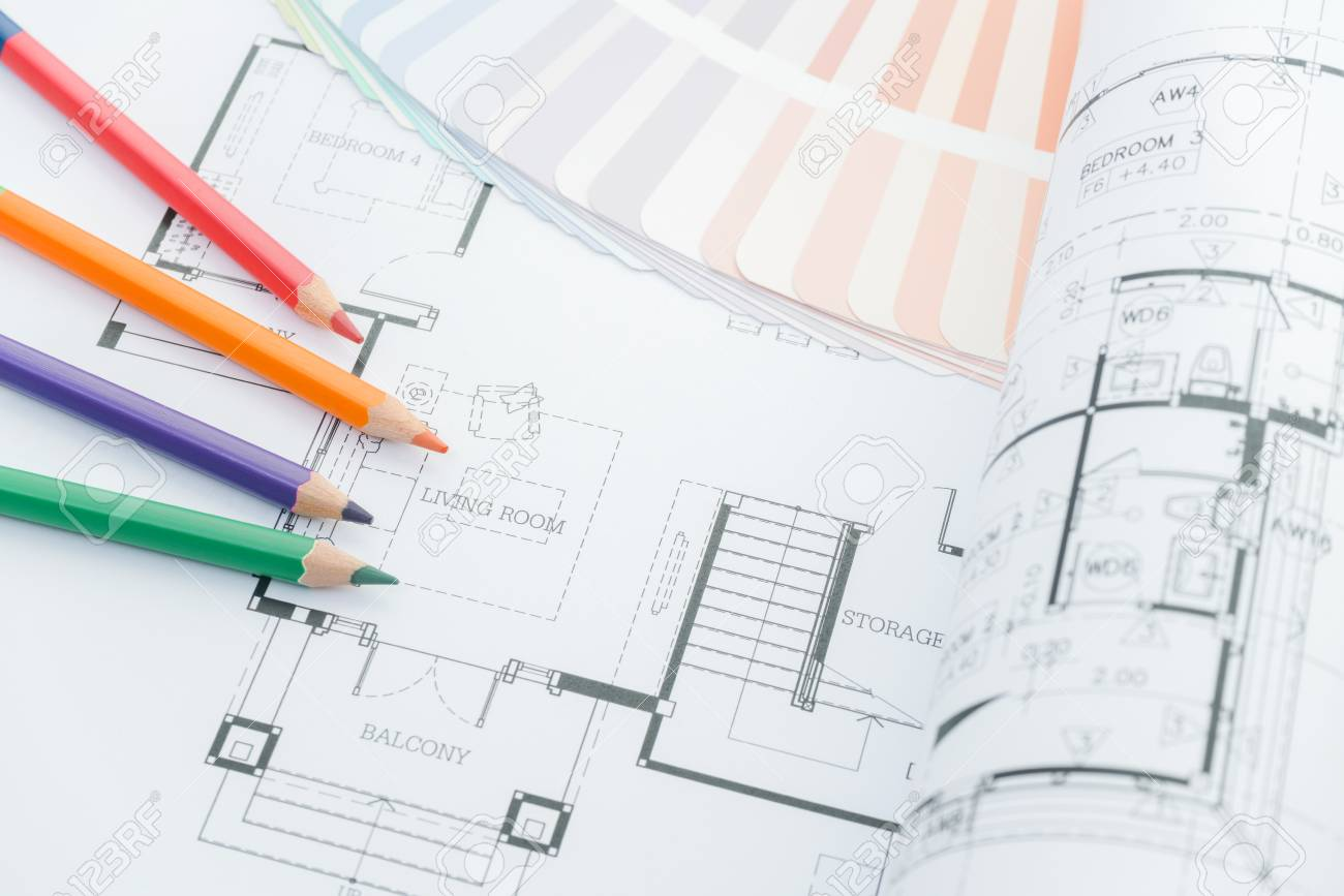 Architects workplace architectural drawings of the modern house with color pencils and sample colors