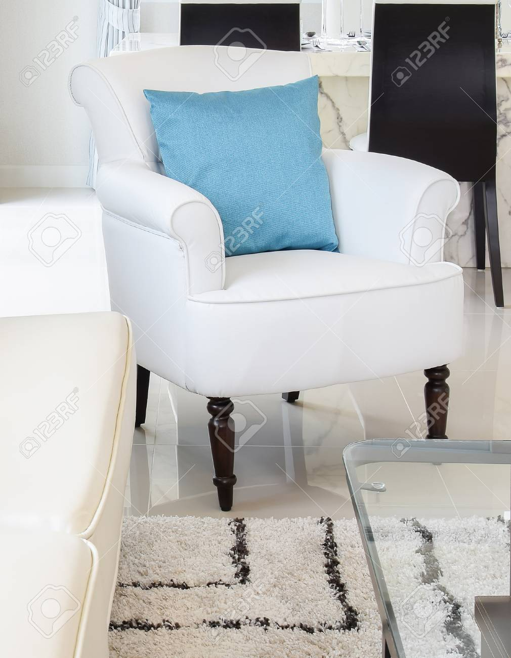 Blue Pillows On A White Leather Couch In Vintage Living Room Stock