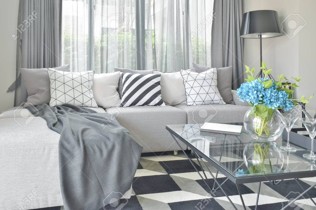 Light Gray L Shape Sofa Set With Varies Pattern And Color Pillows