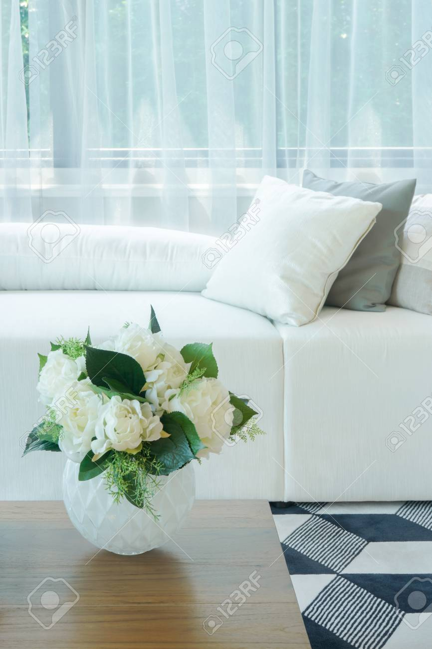 Flower Vase At Center Table With White Sofa In Living Room Stock Photo    83990565