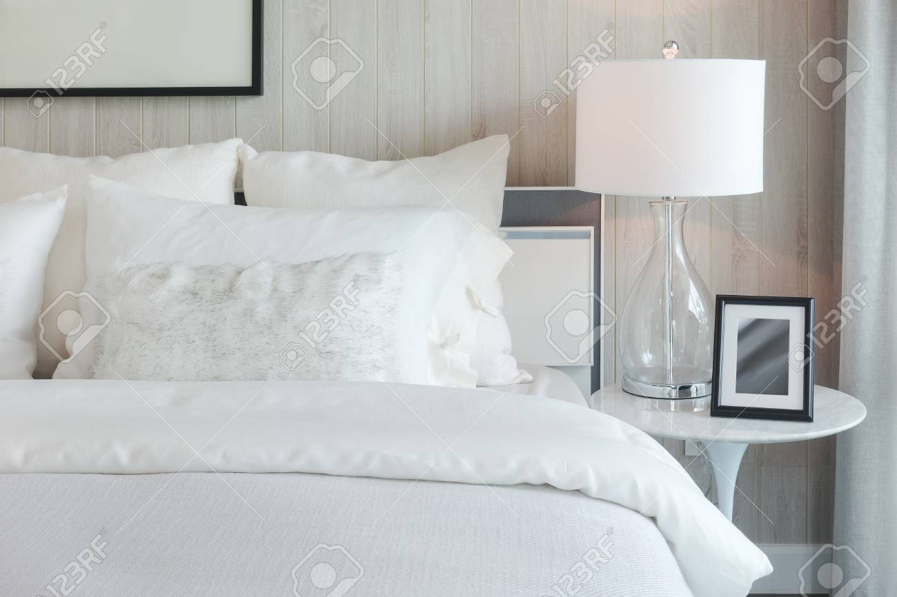 Luxury Style Bedding With Puffy Pillow And White Table Lamp In ...
