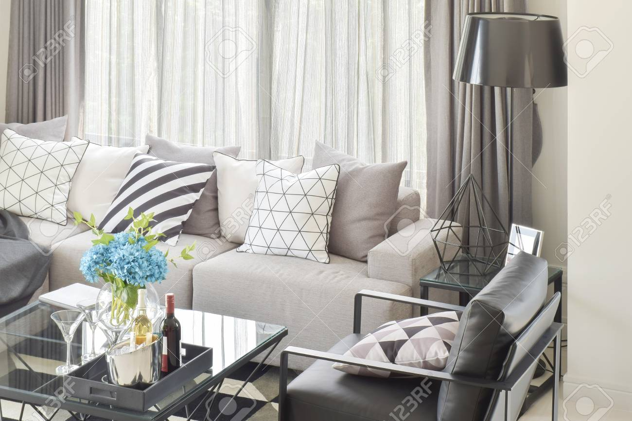 Picture of: Mix Pattern Pillows In Gray Tone Sofa And Wine Bottles On Center Stock Photo Picture And Royalty Free Image Image 84910229