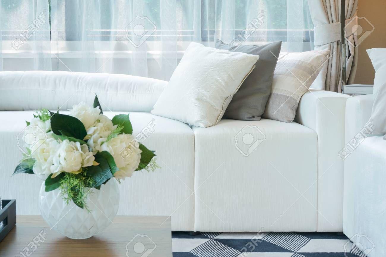 Beau Flower Vase At Center Table With White Sofa In Living Room Stock Photo    99437454