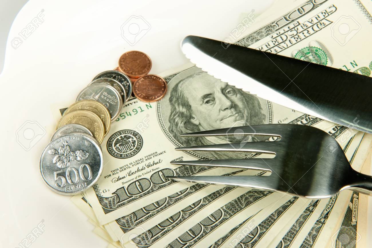 money are food for everbody denomination on plate. Stock Photo - 9144633
