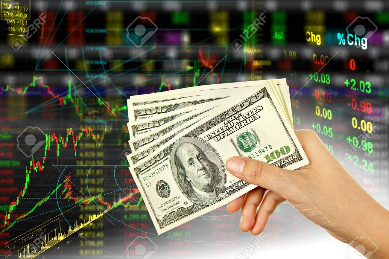 Hand holding dollar in stock background Stock Photo - 10020305