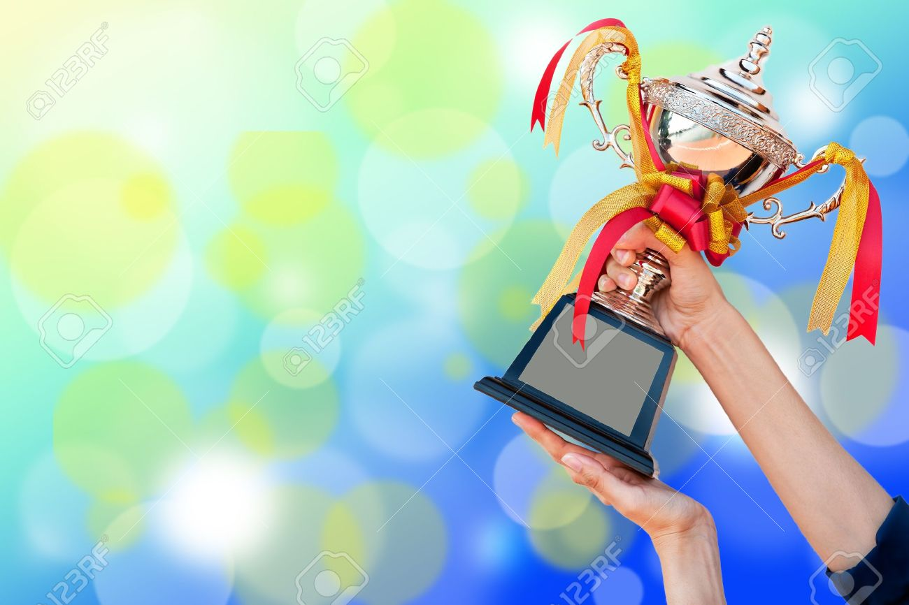 win aword cup in hand Stock Photo - 10644885