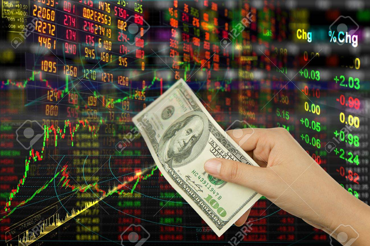 stock exchange graph background and hand holding money Stock Photo - 10644900