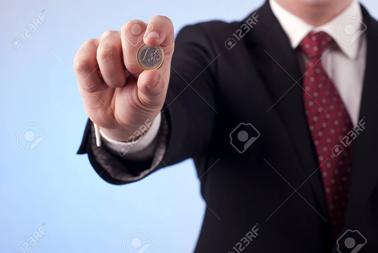A man with one euro coin Stock Photo - 18731045