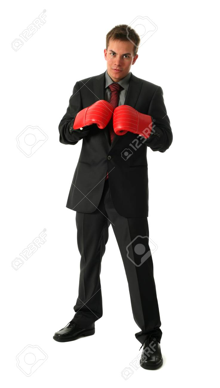 Young businessman wearing boxing-gloves isolated on white Stock Photo - 15459477