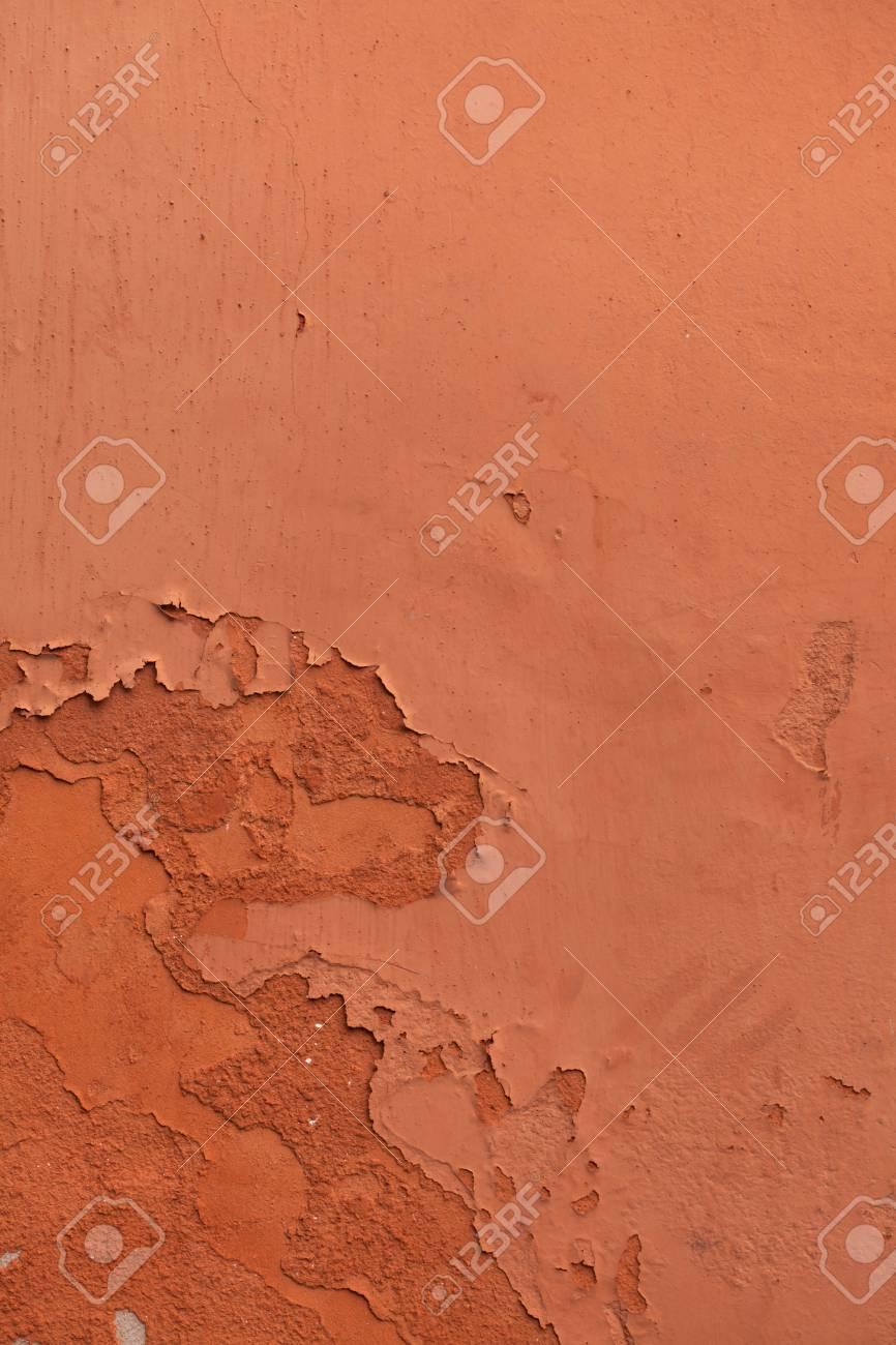 Peinture Couleur Terre Cuite vieille terre cuite peint mur en stuc avec de la peinture écaillée. texture  de fond.