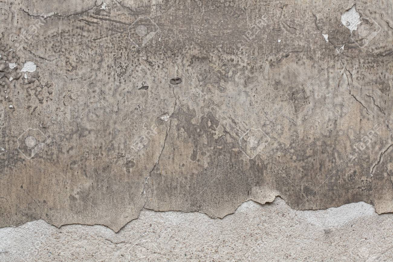 Old grey stucco wall with cracked plaster  Background texture