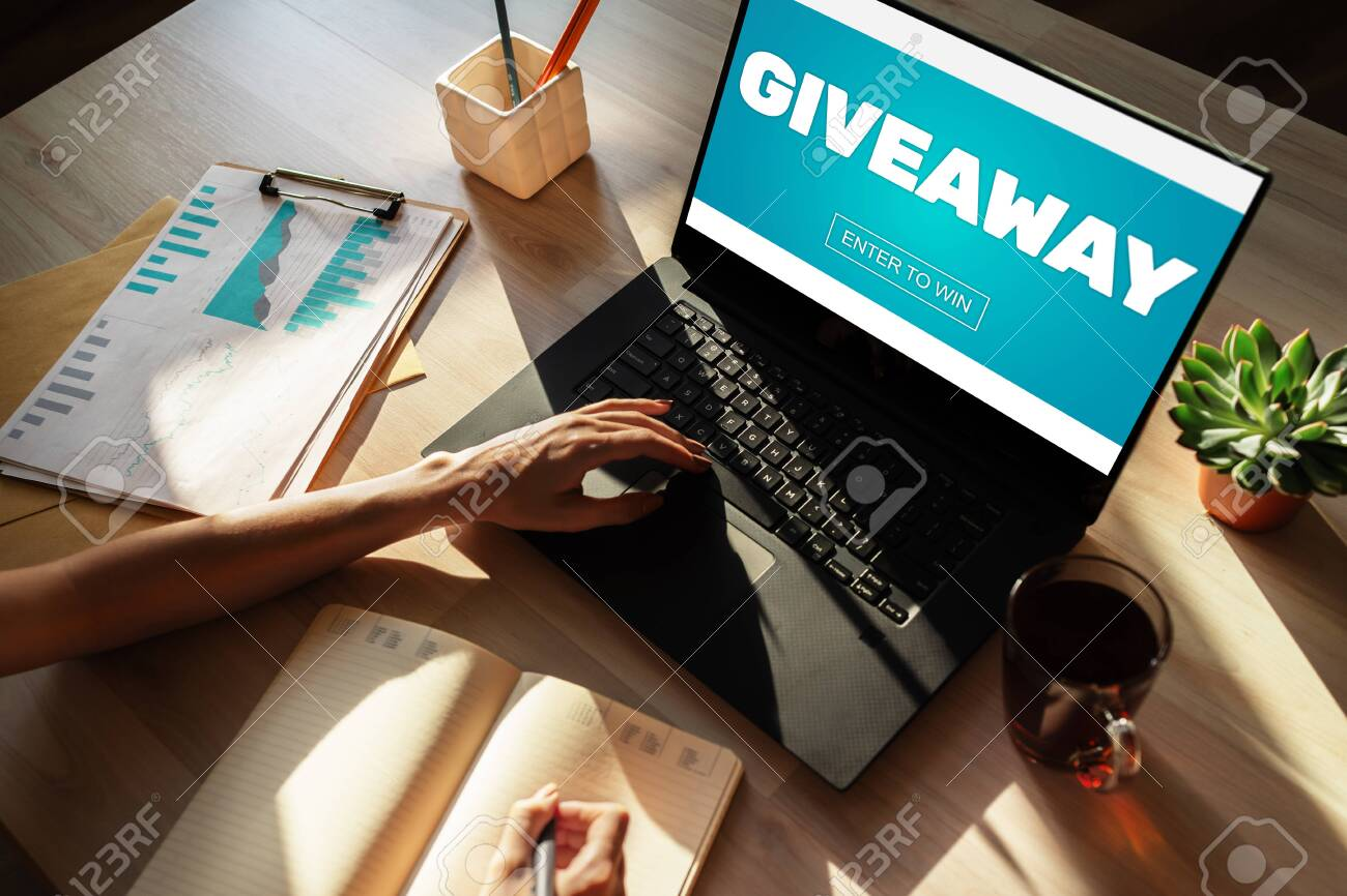 Giveaway, enter to win text on screen. Lottery and prizes. Social media marketing and advertising concept. - 122079804